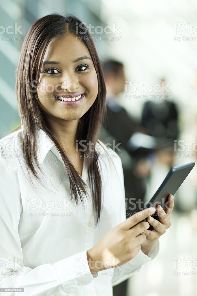 indian office worker holding tablet computer royalty-free stock photo