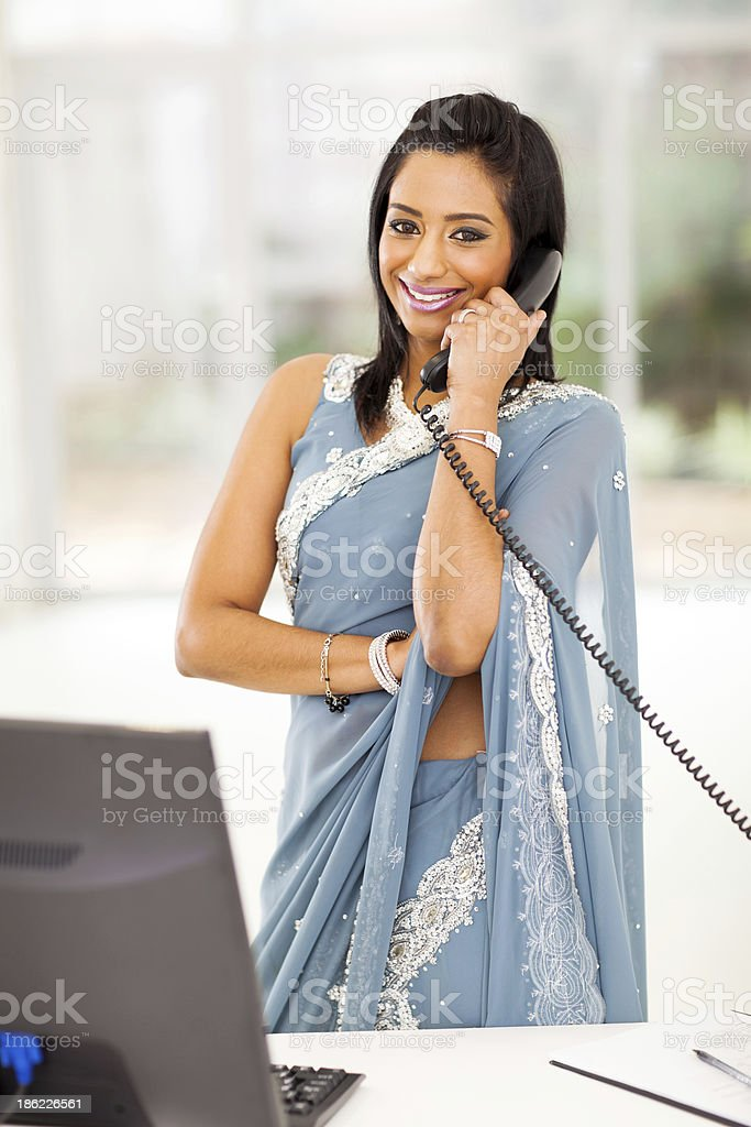 indian office worker talking on the phone royalty-free stock photo