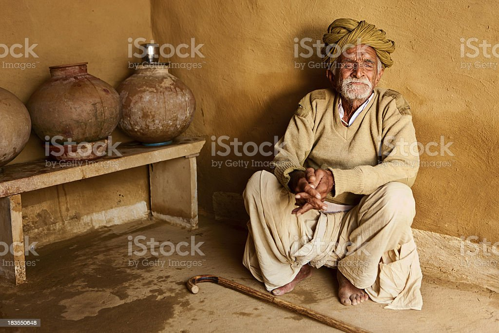 Indian old man sitting inside the hut, Rajasthan royalty-free stock photo