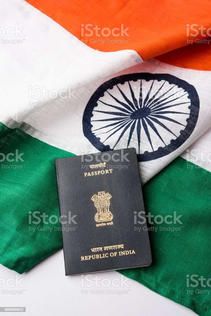 indian passport and authentic indian tricolour flag made up of khadi or pure cotton material stock photo