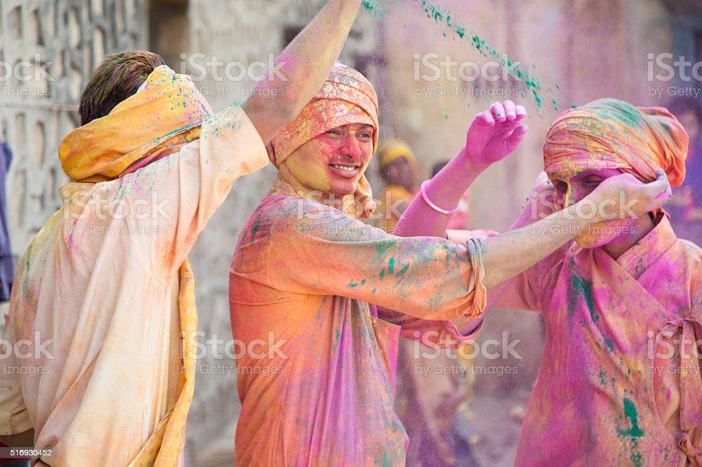 Indian people celebrating holi stock photo