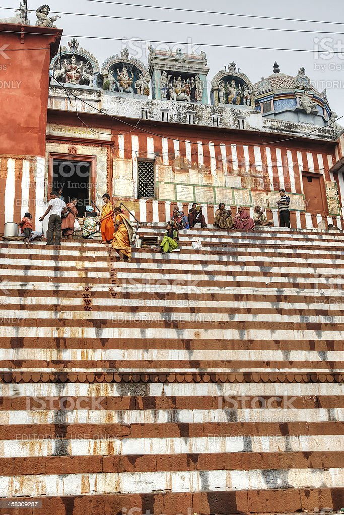 Indian people on steps of the River Ganges stock photo