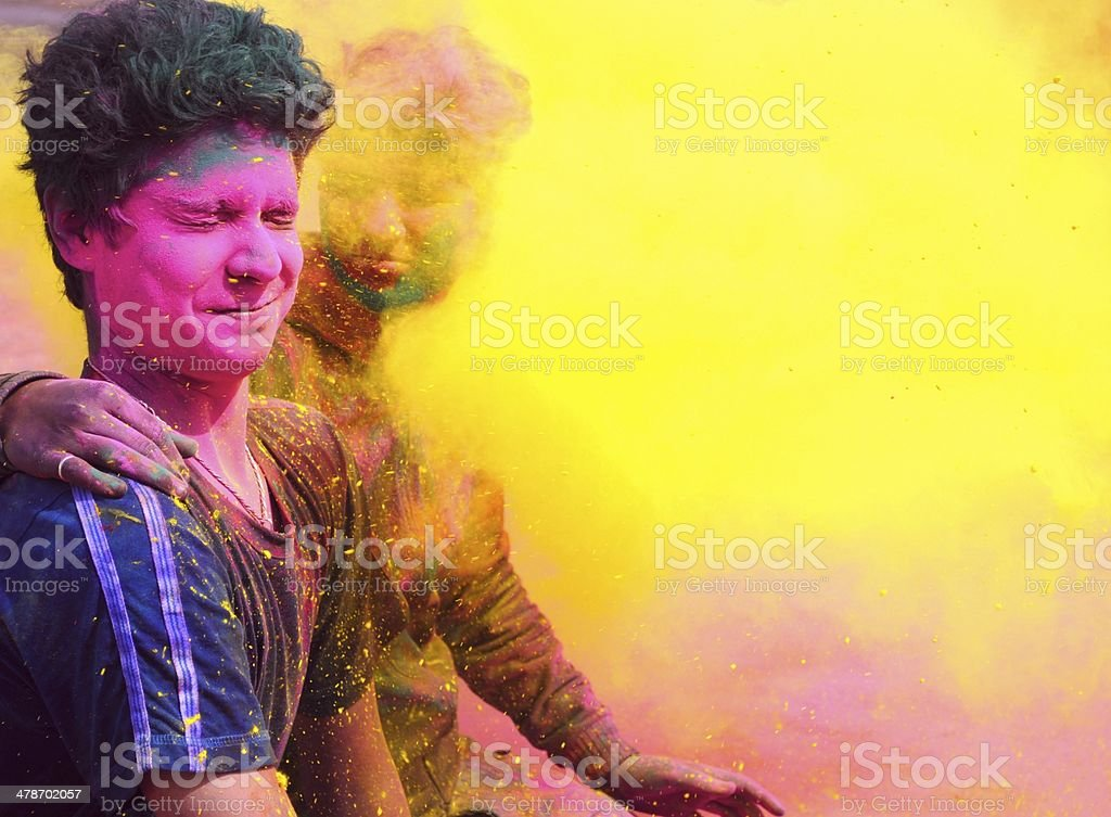 Indian People playing with colorful gulal on Holi. stock photo