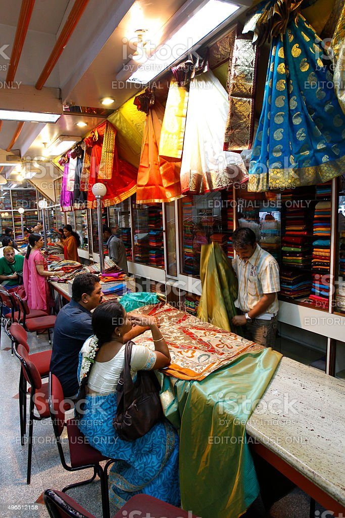 Indian people shopping at a well stocked fabric shop, Mysore stock photo