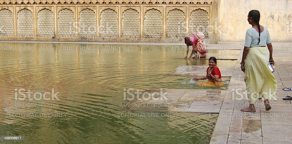 Indian pilgrim women taking bath in holy water. royalty-free stock photo