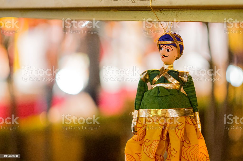 Indian puppet against out of focus background stock photo