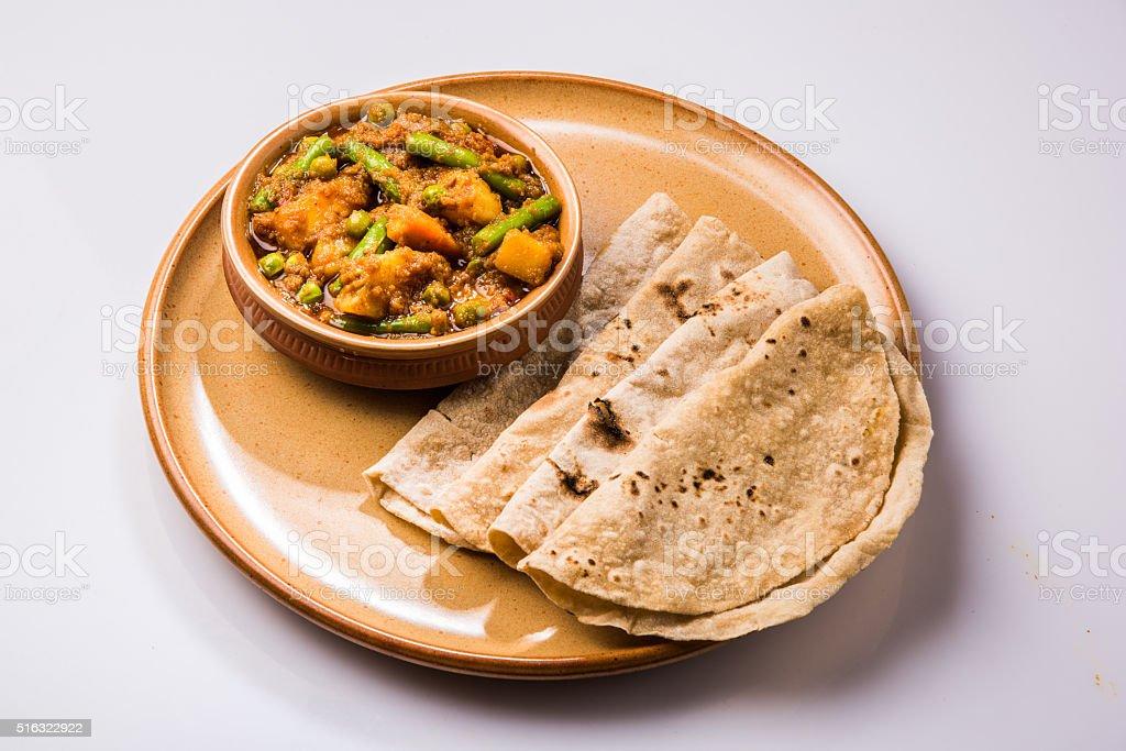 indian recipe mixed veg potato, beans masala curry and chapati stock photo