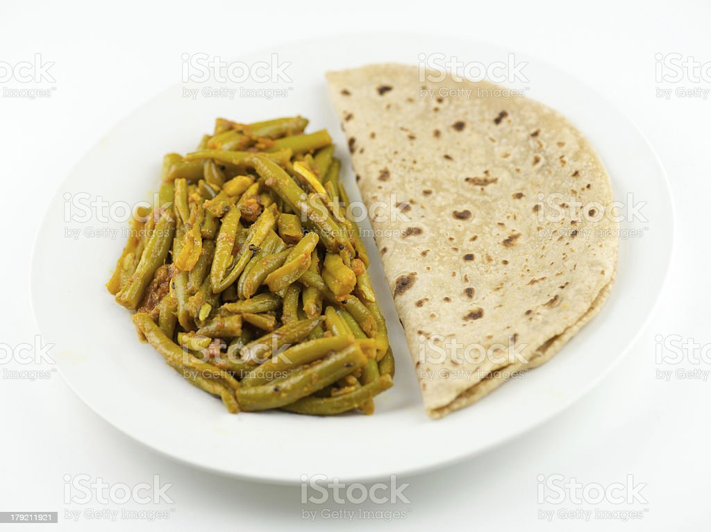 Indian roti and green bean sabzi on white background royalty-free stock photo