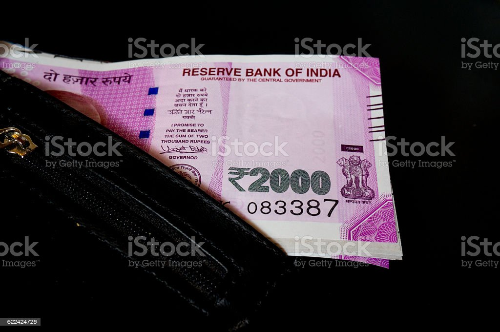 Indian rupee 2000 notes in black leather wallet stock photo