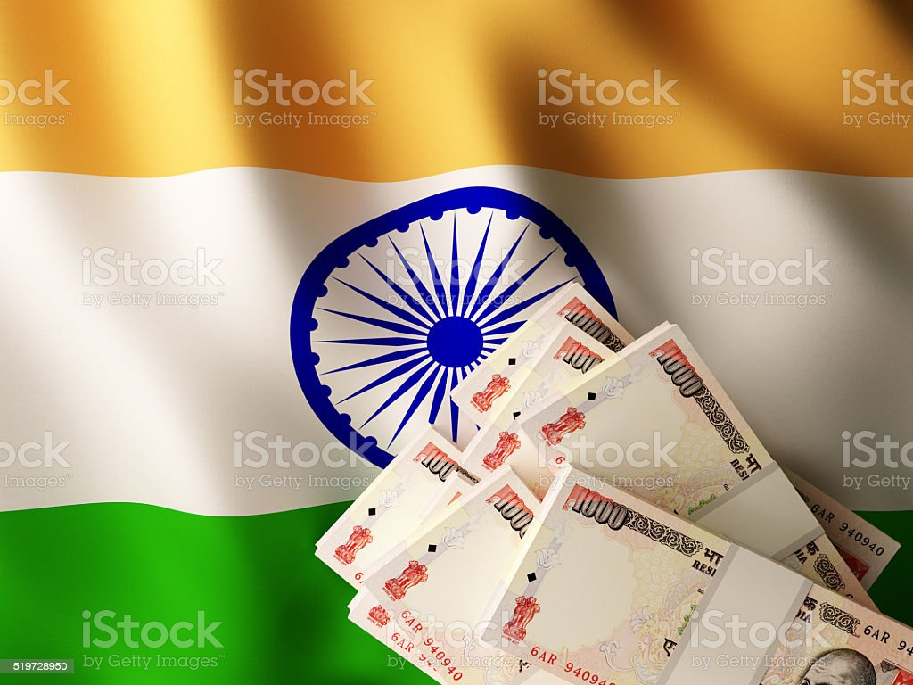 Indian rupee banknotes over India flag stock photo
