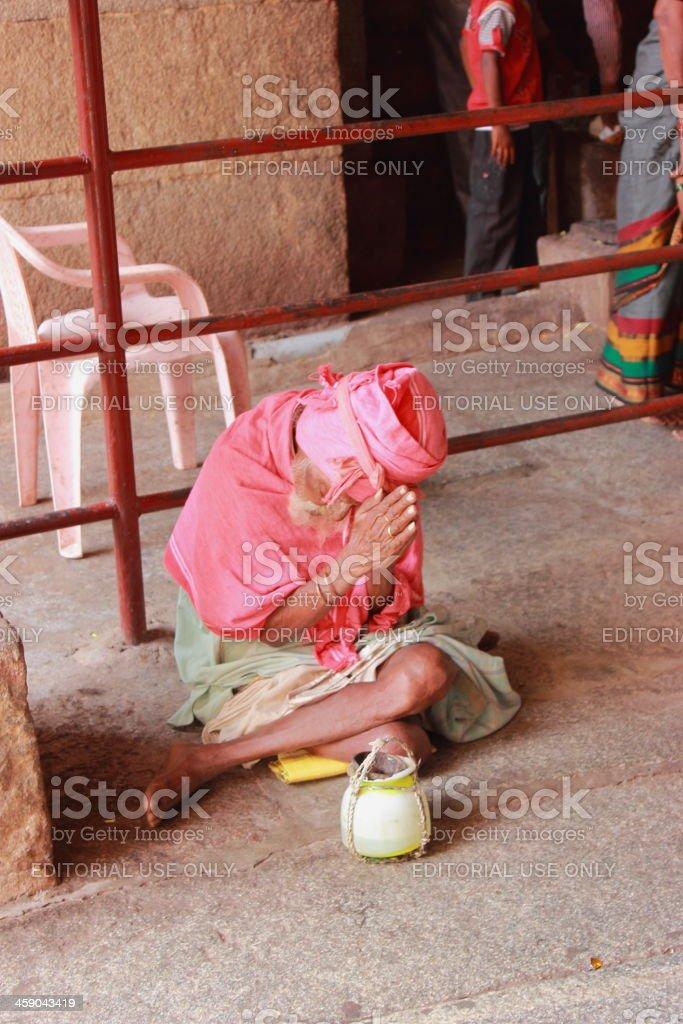 Indian sadhu praying in a temple stock photo