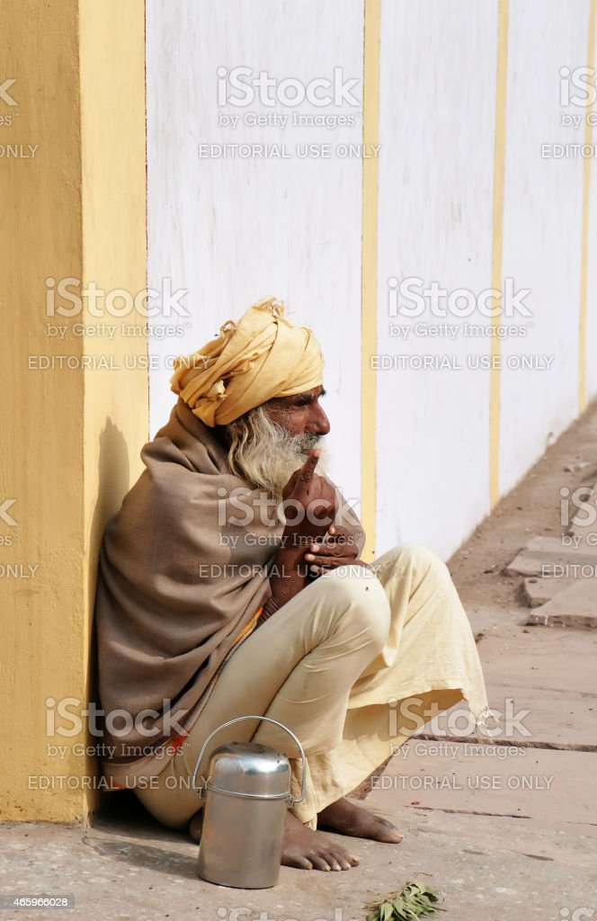 Indian sadhu sits on the street in Vrindavan stock photo