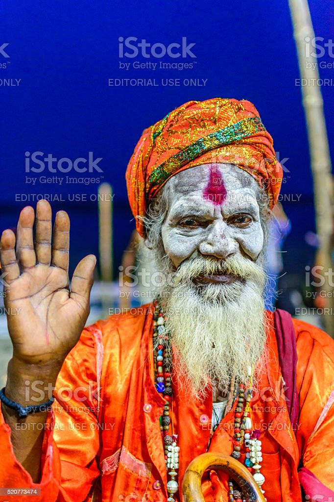 Indian sadhu wearing traditional attire by the sacred Ganges river stock photo