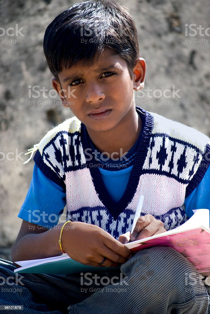 Indian school boy witing in book royalty-free stock photo