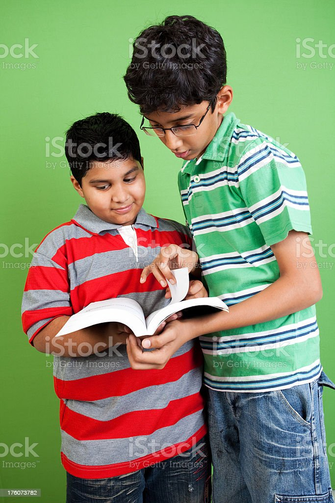 Indian school boys Students discussing vertical shot royalty-free stock photo