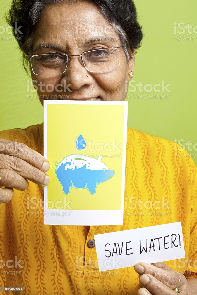 Indian senior woman making an appeal Save Water poster leaflet royalty-free stock photo
