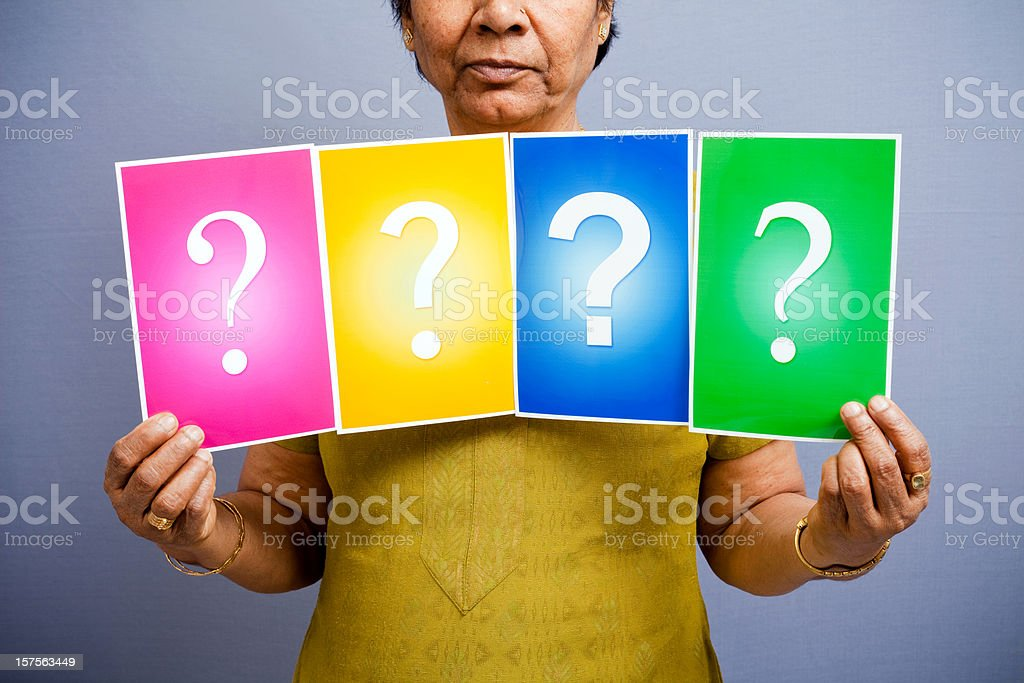Indian Senior Woman with different Question Mark Signs royalty-free stock photo