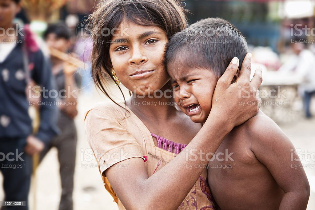 indian siblings boy crying stock photo