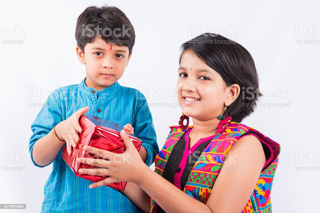 indian small brother and sister having fun on rakshabandhan stock photo