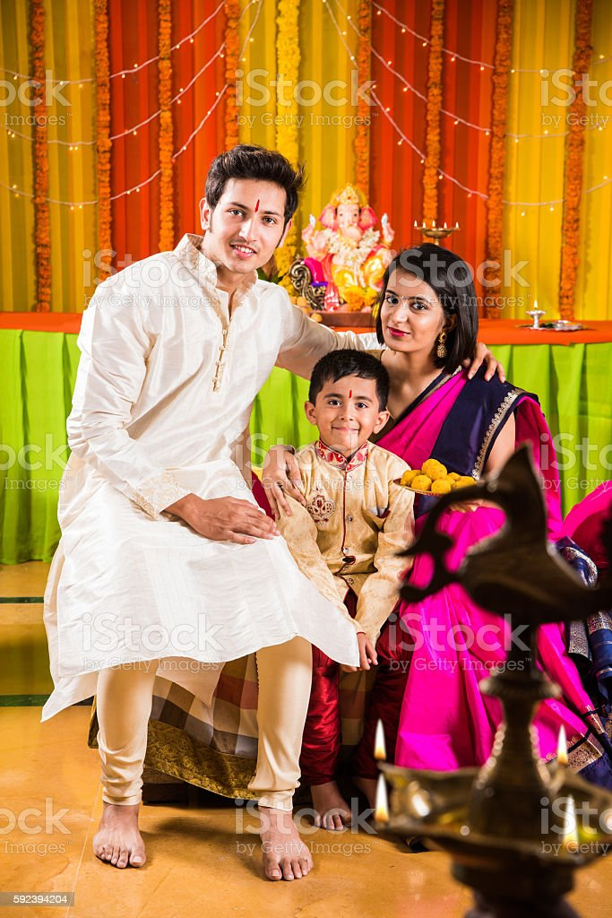 indian smart couple with kid on ganesh festival stock photo