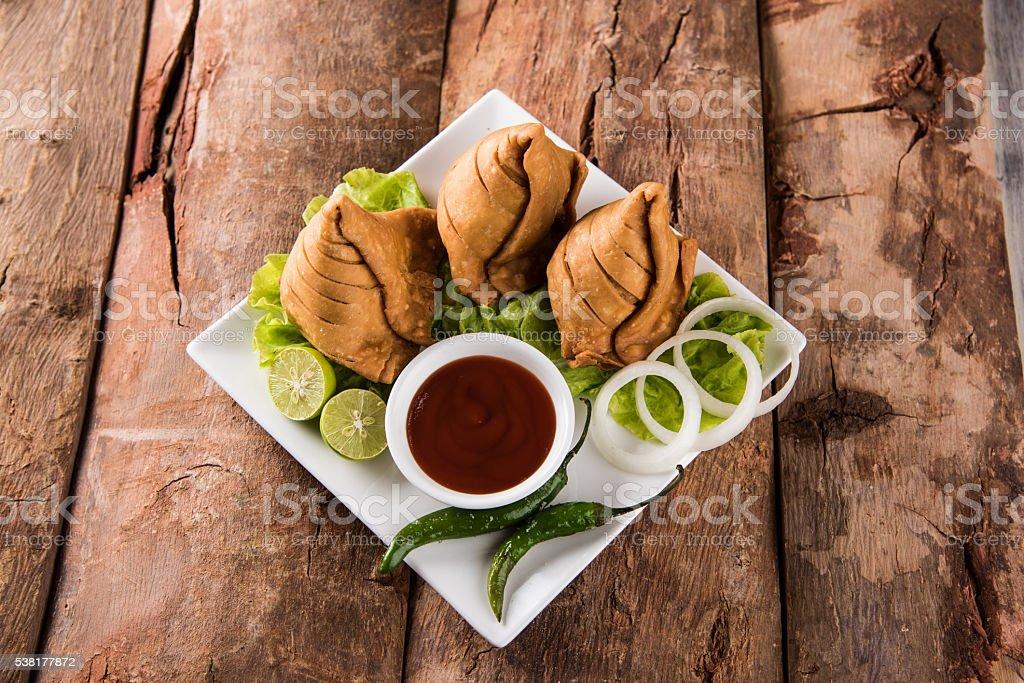 indian snack samosa stock photo