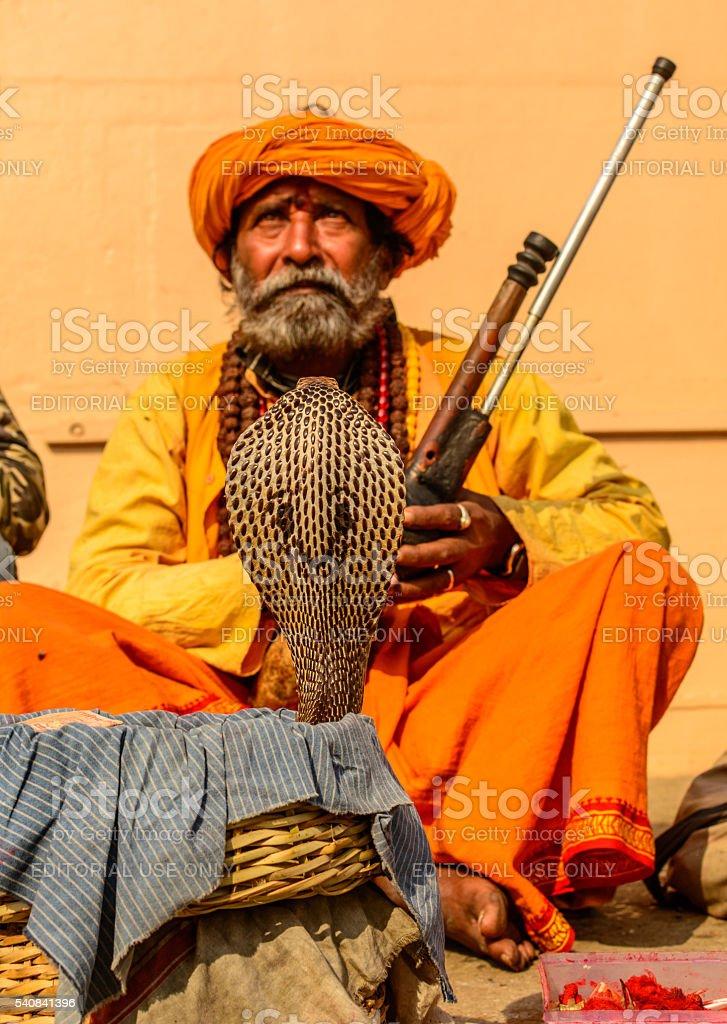 Indian Snake charmer adult man stock photo