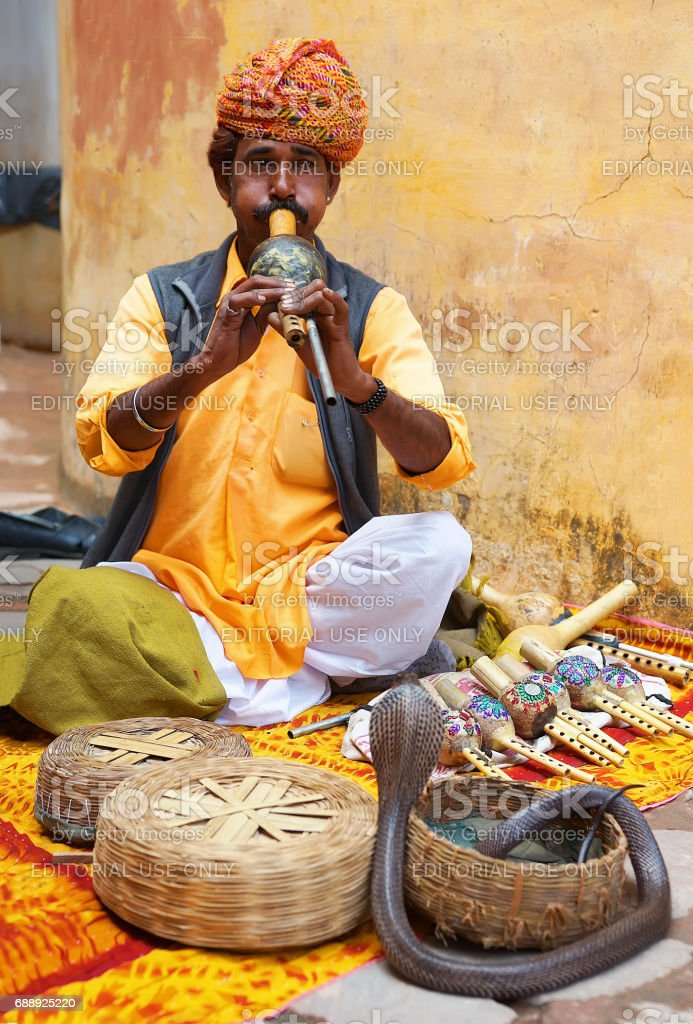 Indian Snake charmer at  Amber Fort in Jaipur, India stock photo
