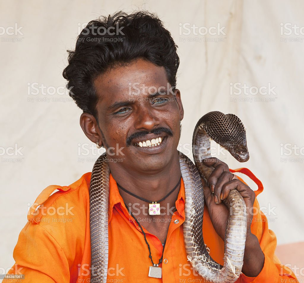 Indian snake charmer with cobra stock photo