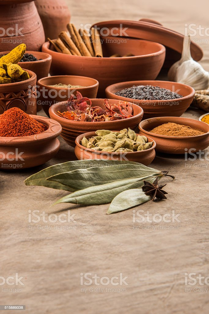 indian spices in terracotta pots, colourful spices, group of spices stock photo