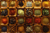 Indian spices in wooden trays.