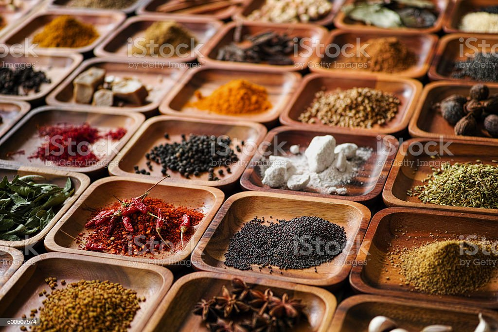 Indian spices in wooden trays. stock photo