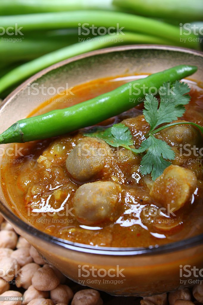 indian spicy chana masala with raw chickpeas and green chilli stock photo