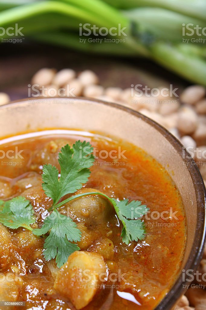 indian spicy chana masala with raw chickpeas stock photo