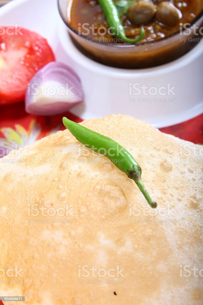 indian spicy dish, chole bhature topping of green chili stock photo