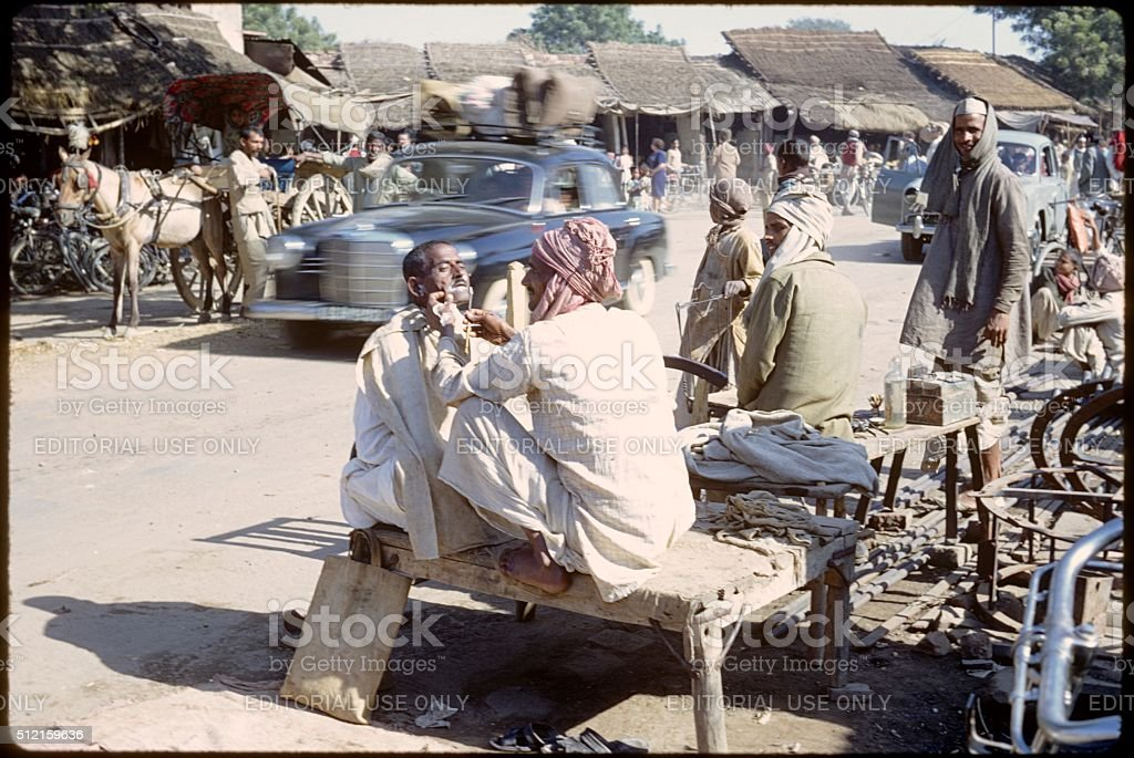 Indian street barber, 1967 stock photo