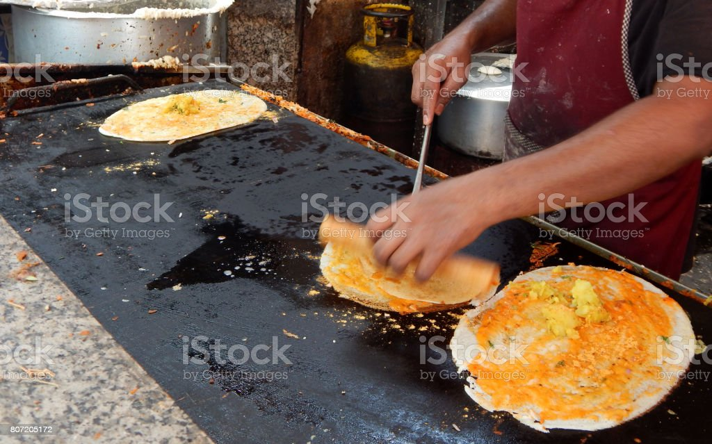 Indian street food-making of Dosa stock photo