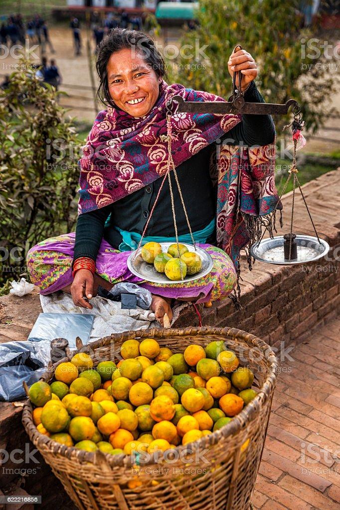 Indian street seller selling fruits in Kathmandu, Nepal stock photo
