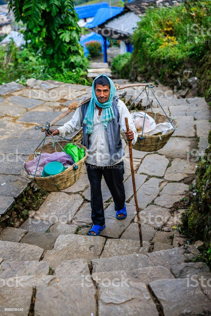 Indian street seller selling plastic in Annapurna Conservation Area stock photo