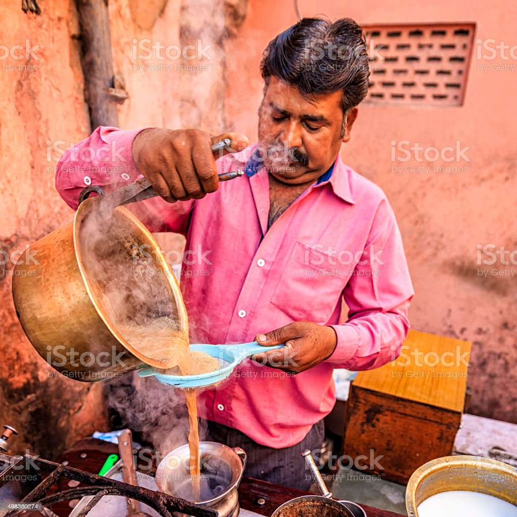 Indian street seller selling tea - masala chai in Jaipur stock photo