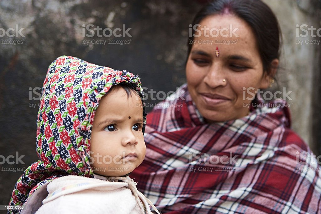 Indian street seller with her baby, royalty-free stock photo