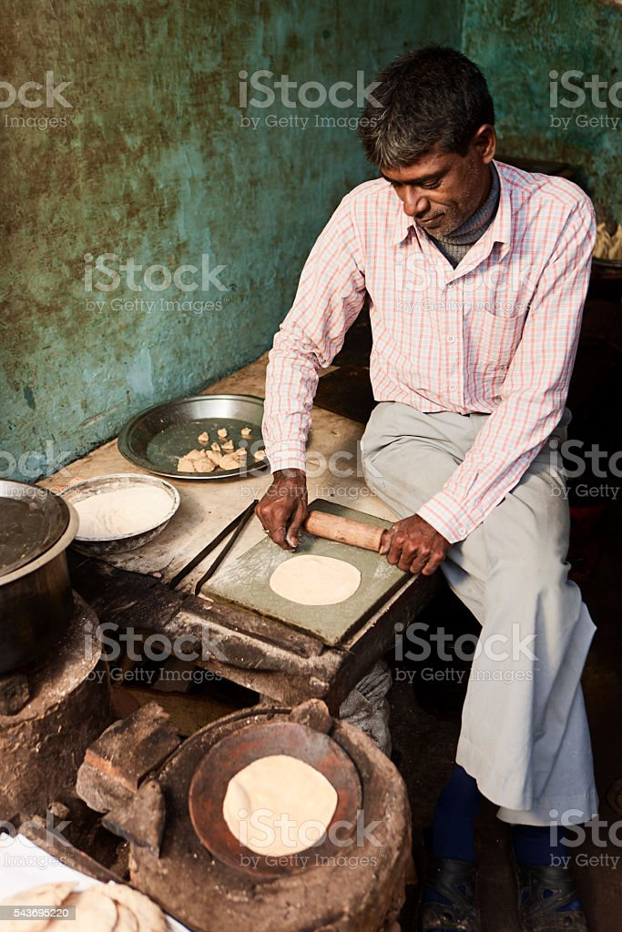 Indian street vendor preparing food - chapatti, flat bread, Jaipur stock photo