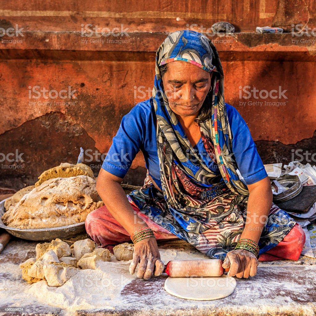 Indian street vendor preparing food - chapatti, flat bread stock photo