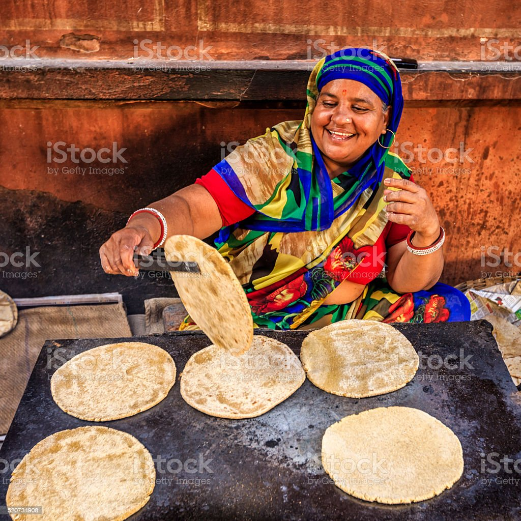 Indian street vendor preparing food - chapatti, flat bread stock photo