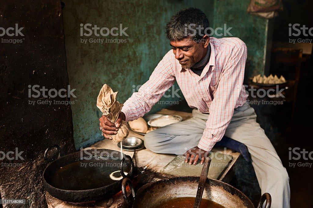 Indian street vendor preparing food - jalebi royalty-free stock photo