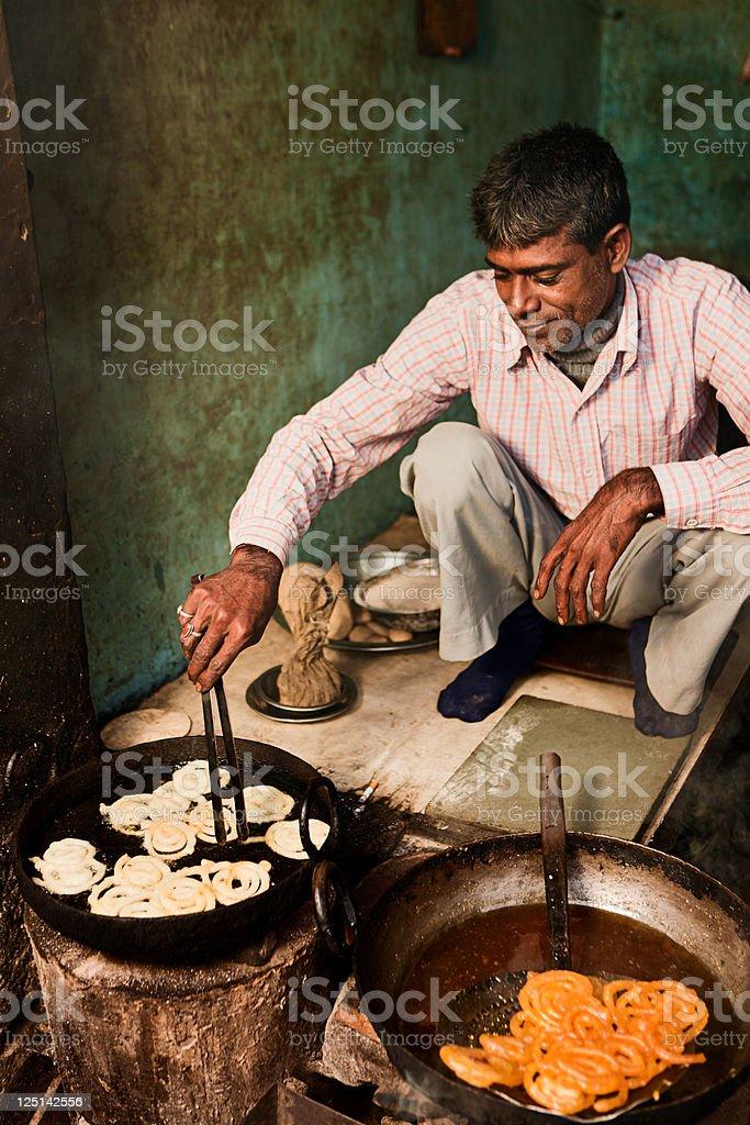 Indian street vendor preparing food - jalebi stock photo