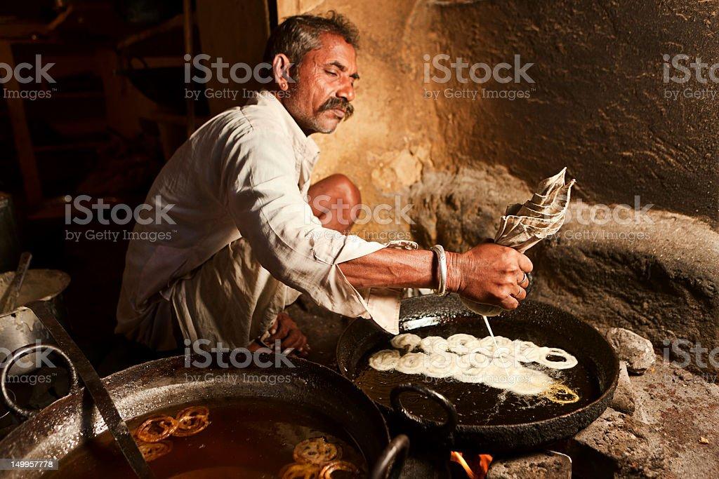 Indian street vendor preparing food stock photo