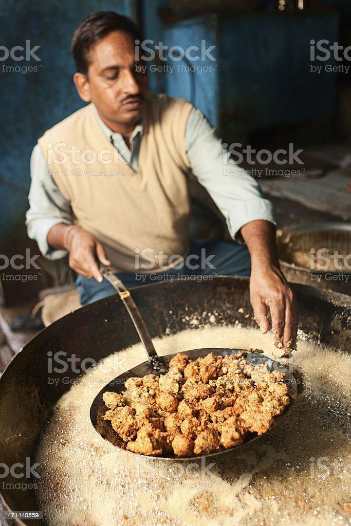 Indian street vendor preparing food royalty-free stock photo