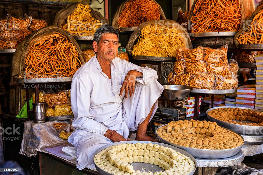 Indian street vendor selling sweets near Jaipur, India stock photo