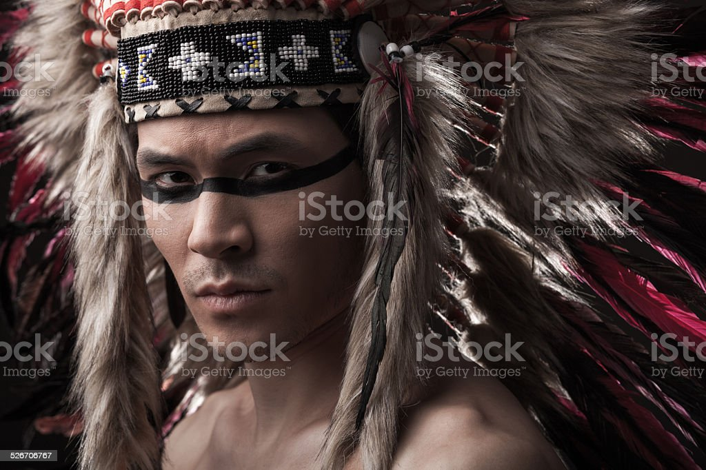 Indian strong man with traditional native american make up stock photo