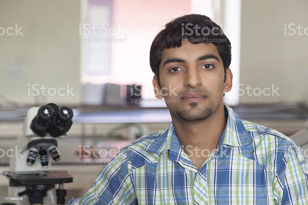 Indian Student With Microscope In A Laboratory royalty-free stock photo